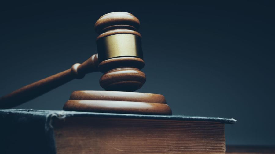 judge mallet on a wooden desk